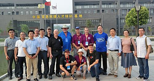 American contingent with Chinese guides touring aeronautical universities in China.
